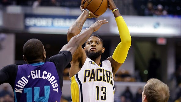 Indiana Pacers forward Paul George (13) puts up a three-pointer