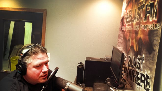 Radio DJ Colin 'Cruz' Strombeck in his TheBlast.FM studio in Emery, South Dakota.