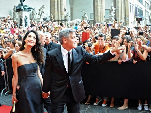 George Clooney on selling the twins' photos: 'We'd like to not do it' 635908892354293276-EPA-ITALY-CHARITY