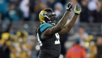 Dec 18, 2014; Jacksonville, FL, USA; Jacksonville Jaguars defensive tackle Sen'Derrick Marks (99) celebrates after a sack on the final play of the game at EverBank Field. The Jaguars defeated the Titans 21-13. Mandatory Credit: Kirby Lee-USA TODAY Sports ORG XMIT: USATSI-180460 ORIG FILE ID:  20141218_krj_al2_287.JPG