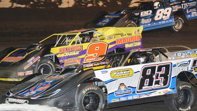 """Scott James (83) races with Eric Smith (9) and Mike Spatola early in the late model feature Saturday at Fairbury Speedway. James went on to win the feature, which was the """"Pappy and Bob Allen Memorial."""""""