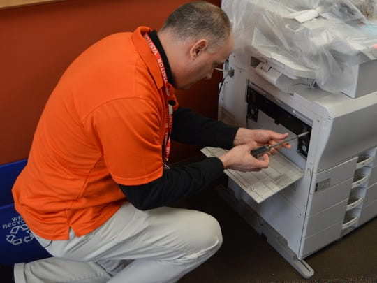 Aaron Kapellusch, president/CEO with the Wausau Region Chamber of Commerce, opens up a copy machine at Northcentral Technical College on Tuesday, Jan. 19, 2016.