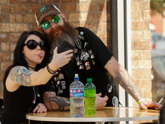 Steve McDonald and Meredith Metzgar take a selfie during the 9th Annual Beard & Moustache Competition for Charity hosted by the  Queen City Beard & Moustache Federation at the 319 Downtown Event Center on Saturday, May 5, 2018.