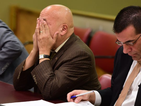 Former Paterson mayor and Jackson business administrator Joey Torres wipes tears from his eyes at his November 2017 sentencing for public corruption during his time as mayor.