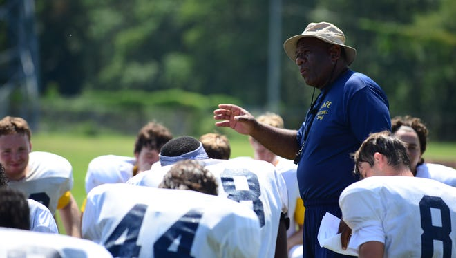 Cape Henlopen head coach Billy Collick speaks to the team during practice on Thursday, Aug. 18, 2016.