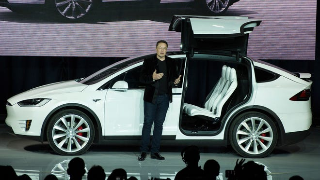 Tesla Motors  CEO Elon Musk unveils the Model X at a launch event in Fremont, Calif.