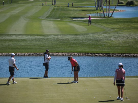 Golfers practice on 18 at Mission Hills Country Club in Rancho Mirage on Tuesday, March 28, 2017 for ANA Inspiration.