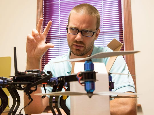 UMES Aviation Science lecturer Christopher Hartman explains the various components of his drone at UMES on Thursday.