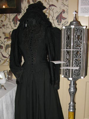 "This Victorian-style mourning dress is part of the ""A House in Mourning"" exhibit at Alexander Noble House Museum in Fish Creek."