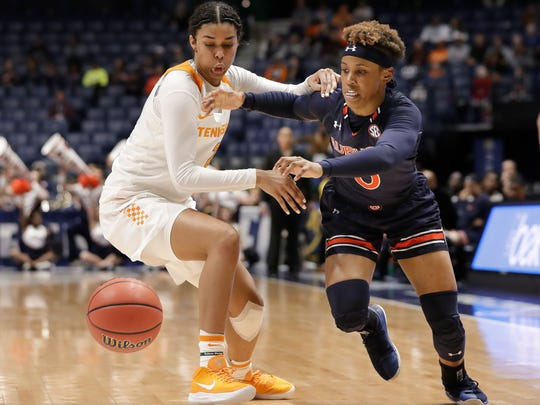 Tennessee guard Evina Westbrook, left, and Auburn guard Daisa Alexander chase after the ball in the first half of an NCAA college basketball game at the women's Southeastern Conference tournament Thursday, March 1, 2018, in Nashville, Tenn. (AP Photo/Mark Humphrey)