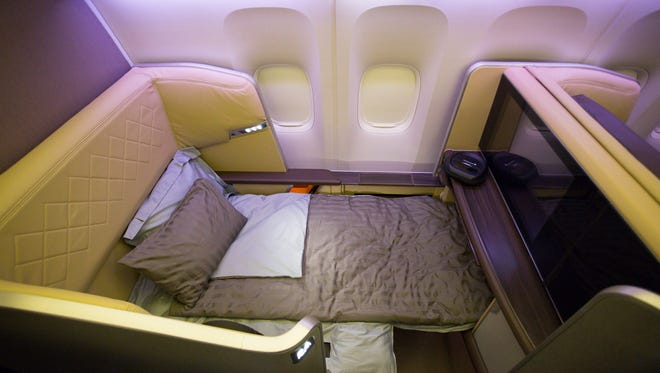 first-class seat in the first Singapore Airlines Boeing 777-300ER to be configured with its all-new interior. This seat reclines into a full-flat bed for sleeping.
