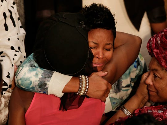 Friends and family member line up to hug Faith Green