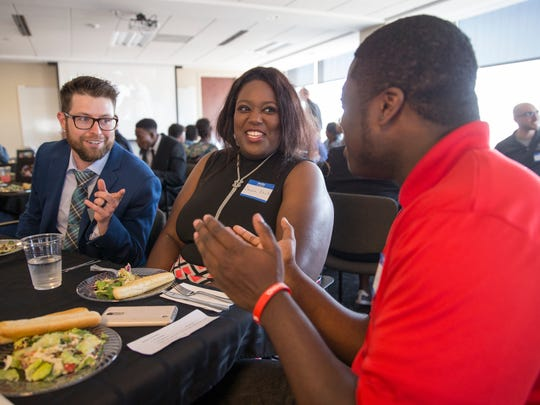 Eric Muller (left), Executive Director, sits with Sandra Davis, and her son, Dwight Bunton, who's with other graduating high school seniors who have participated in Dream Alive, a mentorship program founded by former Colts player Tarik Glenn, Indianapolis, Wednesday, May 31, 2017.
