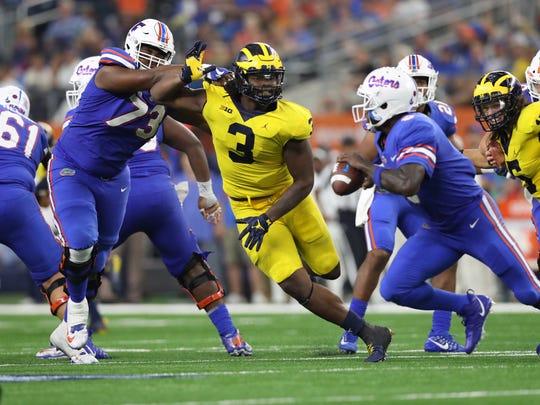 Sep 2, 2017; Arlington, TX, USA; Michigan Wolverines defensive end Rashan Gary pressures Florida Gators quarterback Malik Zaire in the second half at AT&T Stadium.