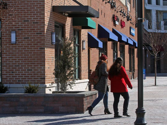 What does Somerset County and Somerville have to offer Millennials? Pedestrians walks in the area of Starbucks on Main Street in Somerville.