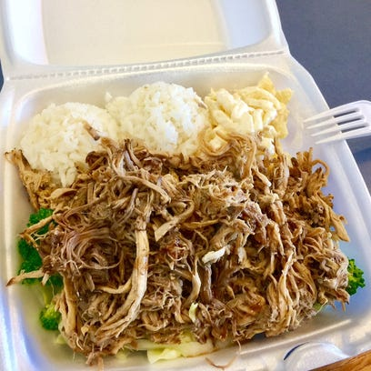 Kalua pulled pork with rice, mac salad and vegetables.