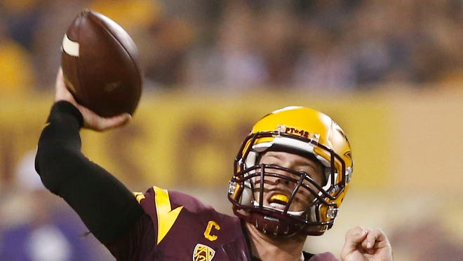 Arizona State's Taylor Kelly throws a pass against Weber State during both teams' season opener on Thursday, Aug. 28, 2014, at Sun Devil Stadium in Tempe.