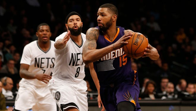 Suns forward Marcus Morris (15) drives by Brooklyn Nets guard Deron Williams (8) during the second  half at Barclays Center in Brooklyn on March 6. The Phoenix Suns won 108-100.