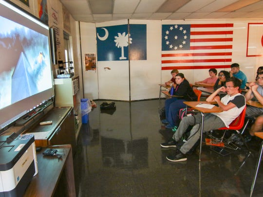 Students in Taylor Hollifield's Palmetto High School U.S. History class watch video from the the events of September 11, 2001. The students were infants at the time of the historic events.