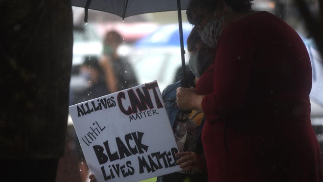 People gather to listen to speakers and show support for George Floyd at the 1898 Memorial Park in downtown Wilmington, N.C, Saturday, May 30, 2020. Black Lives Matter and the New Hanover County chapter of the National Black Leadership Caucus organized the event.