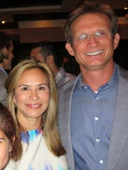 Schanda and Michael Handley are seen at a social function in Lafayette, La.