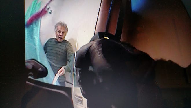 "This image provided by Burlington police shows Ralph ""Phil"" Grenon in the shower at his Burlington apartment as an officer aims a Taser at him. The stun device failed to subdue him, and he charged at officers, one of whom opened fire with a handgun and killed Grenon, 76, in March."