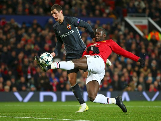 Manchester United's Romelu Lukaku, right, scores a goal as CSKA's Viktor Vasin tries to block during the Champions League group A soccer match between Manchester United and CSKA Moscow in Manchester, England, Tuesday, Dec. 5, 2017. (AP Photo/Dave Thompson)