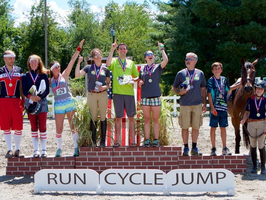 The winners of the 2016 Trihoofalon stand on the podium.