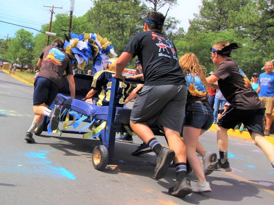 Ruidoso teens race swiftly up hill hoping to clinch first place.