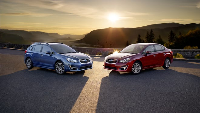 """Four door and five door versions of the 2015 Subaru Impreza, which were named as the """"Top Pick"""" in the compact car category by Consumer Reports on Feb. 23, 2016."""