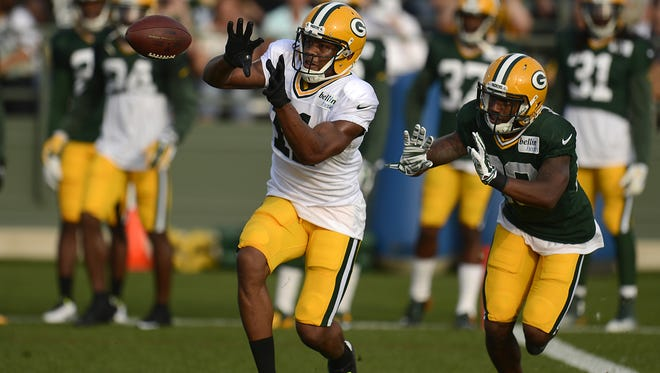 Green Bay Packers receiver Jarrett Boykin (11) makes a catch in front of cornerback Casey Hayward (29) during training camp practice at Ray Nitschke Field on Monday, Aug. 4, 2014. Evan Siegle/Press-Gazette Media