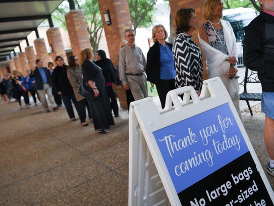 People queue for transportation to St. Martin's Episcopal Church Friday to pay their respect to former first lady Barbara Bush.