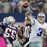 Dallas quarterback Brandon Weeden throws a pass against the Patriots during the first quarter Sunday.