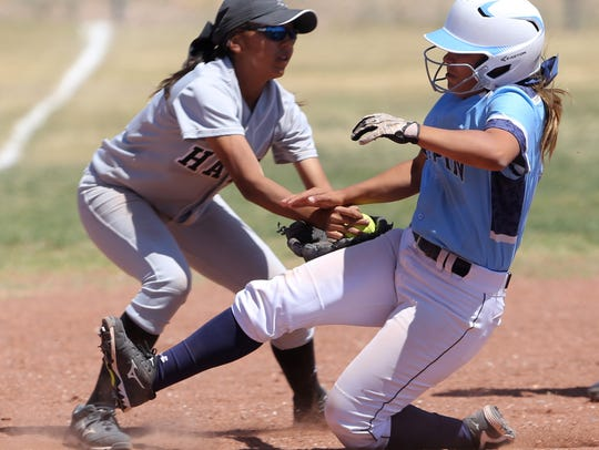 Hanks third baseman Veronica Rodriguez tags out a sliding