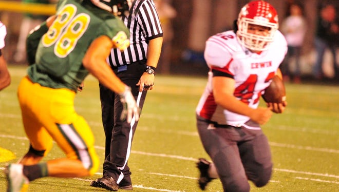 Erwin and Trevor Franklin, right, beat Reynolds by a 27-24 score on Sept. 26.