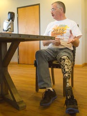 David Dunville is confident his new programmable prosthetic leg will give him greater mobility.