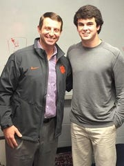 Clemson coach Dabo Swinney, left, is pictured with Nolan Turner on National Signing Day.