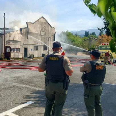 Firefighters work to extinguish a fire that broke out