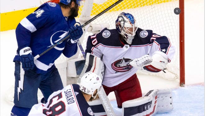Joonas Korpisalo makes one of his 36 stops in the Blue Jackets' 3-1 victory against the Tampa Bay Lightning om Thursday, splitting the first two games of a series that began with a five-overtime loss for Columbus on Tuesday.