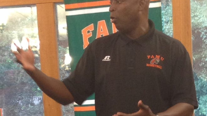 Incoming FAMU men's basketball coach Byron Samuels answers a question from members of the 220 Quarterback Club.