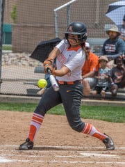Aztec's Jocelyn Ulrich hits an RBI single against Artesia on Saturday in Albuquerque.