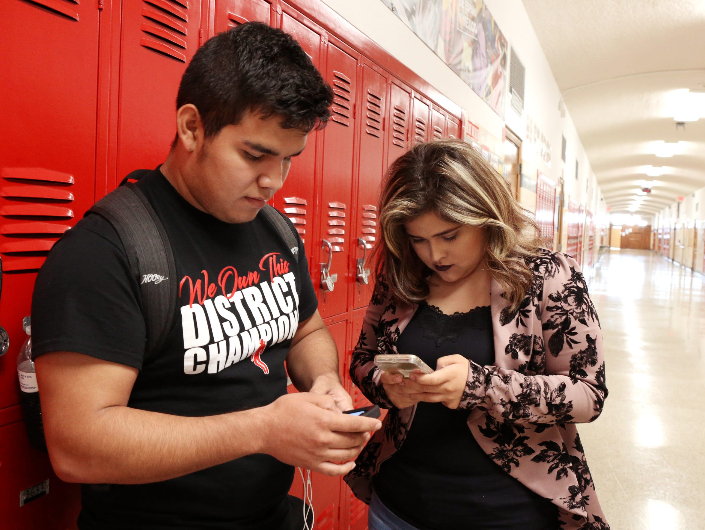Sergio Alfaro, 19, and Claudia Jimenez, 17, hang out