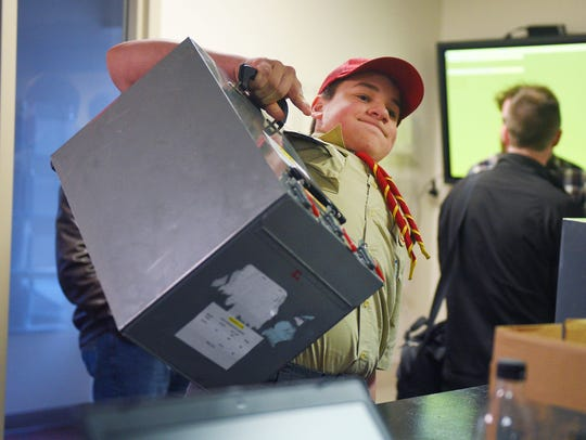 Boy Scouts Troop 48 Gabe Dvorak brings in voting ballots