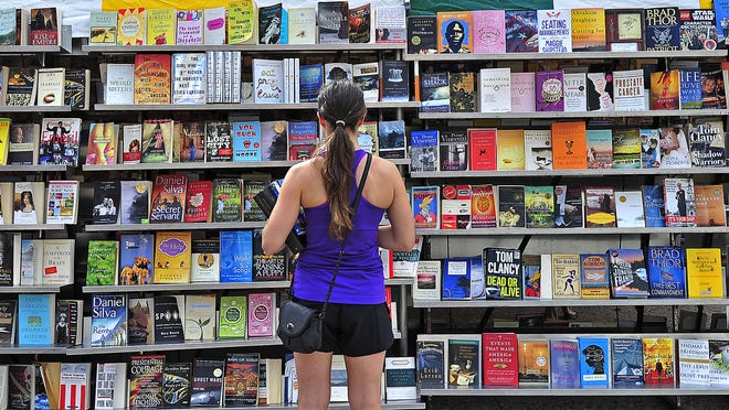 Becky Williams peruses a wide variety of books on display during the 2013 Southern Festival of Books at War Memorial Plaza in Nashville. The 26th annual event will take place Oct. 10-12.