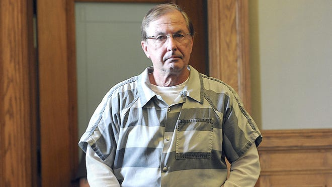 Wendell Racette enters the Ingham County Circuit Court in Mason in 2012 for sentencing.