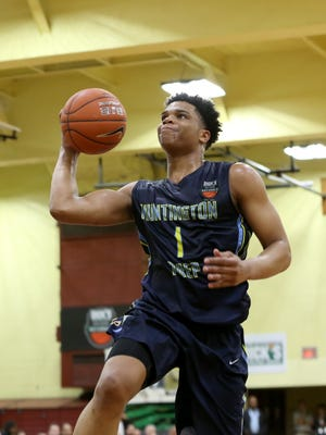 Huntington Prep's Miles Bridges #1 in action against Oak Hill Academy in the DICK'S Sporting Goods High School National Basketball Tournament on Friday, April  3, 2015 in Queens, NY. Oak Hill Academy won the game to advance to the finals.  (AP Photo/Gregory Payan)