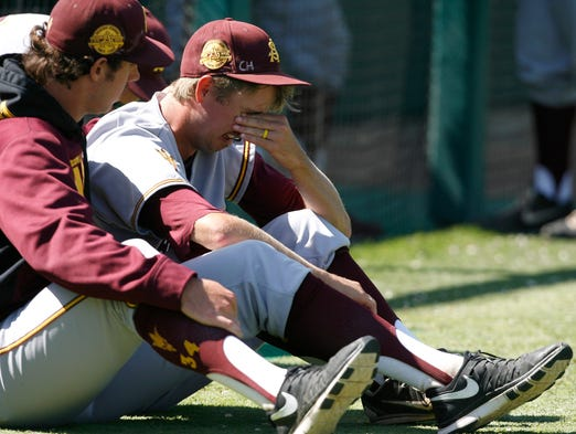 Arizona State's Josh McAlister, right, is consoled by a teammate following their loss to Sacramento State in an NCAA college baseball tournament regional game on Saturday, May 31, 2014, in San Luis Obispo, Calif.