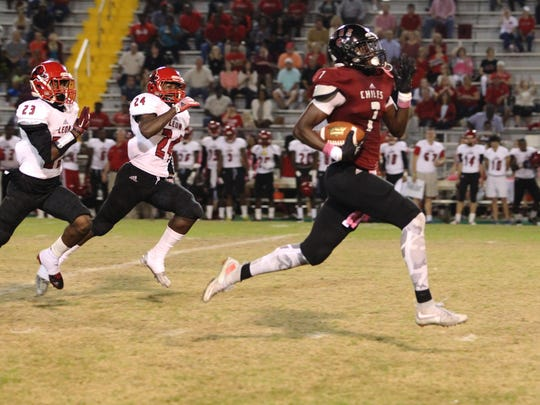 Chiles receiver John Mitchell sprints for an 80-yard