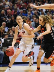 Apr 3, 2016; Indianapolis, IN, USA; Oregon State guard Katie McWillilams (right) plays defense against national player of the year Breanna Stewart of UConn in last season's Final Four at Bankers Life Fieldhouse.