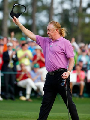 Miguel Angel Jimenez acknowledges the cheers at the 18th green.